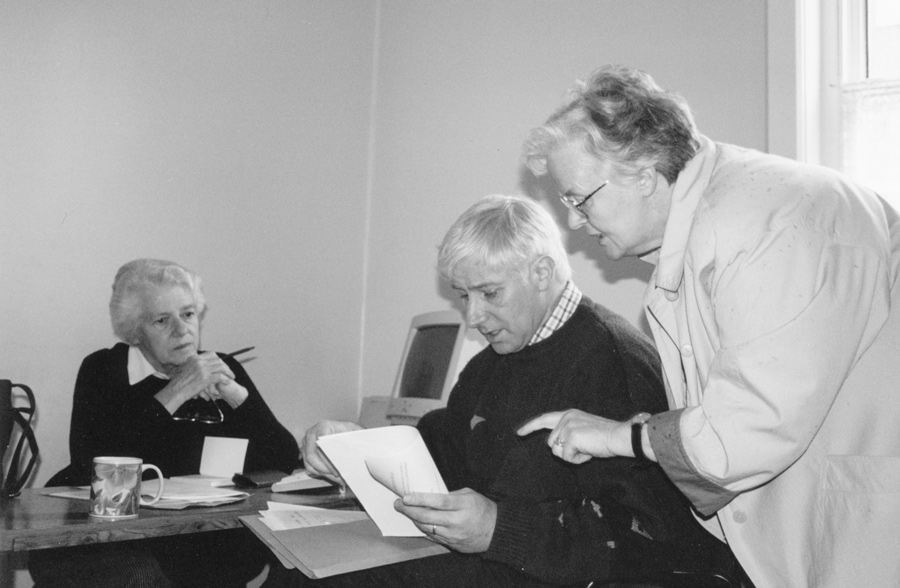 Mossie Lyons, the first manager of Kairos Bethwin Road, with bookkeeper Rosemary Noble (left) and another volunteer.