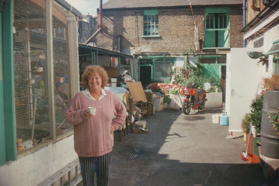 Betty Fleming in front of the aviary in the transformed Stonhouse Street yard.